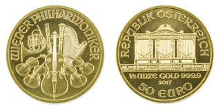 Gold coin on a white background. Gold coin Austria 1/2 ounce Vienna Philharmonic. Isolated stock photography