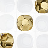 Gold coin in white cup Royalty Free Stock Photos