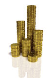 Gold coins. Stacks of gold coins on white background Royalty Free Stock Photos