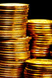 Gold coins. Stacks of the gold coins close up Royalty Free Stock Image