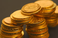 Gold coins. On the dark background Royalty Free Stock Photo