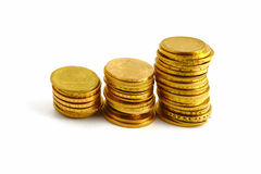 Gold coins. On the white background Stock Images