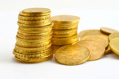 Gold coins. On the white background Stock Photos