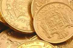 Gold coins. Old gold coins and gold investment coins Royalty Free Stock Photography