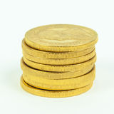 Gold Coins. Stacked krugerrand wealth currency Royalty Free Stock Photo