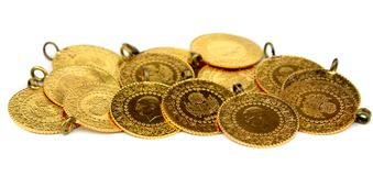 Gold coins. On white background. Close up image stock photo