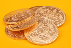 Gold coins. In Golden tone with yellow background royalty free stock images