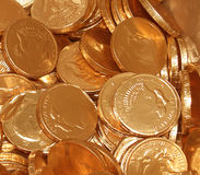 Gold Coins. A cluster of shimmering chocolate gold coins Royalty Free Stock Photos