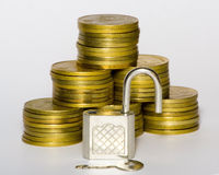 Gold coins. With lock and key stock photo