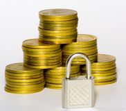 Gold coins. With lock Royalty Free Stock Images