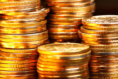 Gold coins. Stacks of the gold coins close up Stock Images