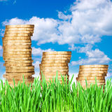 Gold coins against the sky money concept Royalty Free Stock Photo