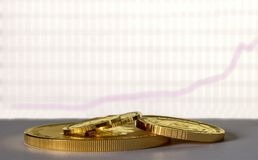 Gold coins on the background of the growth chart. Selective focus stock image