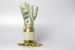 Gold Coins, Bank Notes and Jar - Financial Concept Stock Photography
