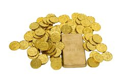 Gold Coins and Bar. Large gold bar with many gold coins showing success, wealth and luxury - path included Stock Image
