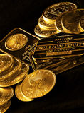 Gold Coins and Bars for Wealth Royalty Free Stock Images