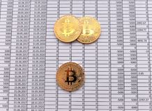 Gold Coins Bitcoin on white background with numbers. price of bi. Tcoin concept,  numbers of zero Stock Photography