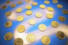 Gold Coins. On Blue Background stock photography