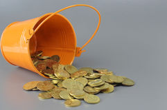 Gold Coins and Bucket - Business Concept Royalty Free Stock Images