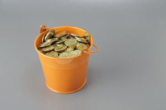 Gold Coins in the Bucket - Financial Concept Royalty Free Stock Photo