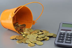 Gold Coins, Calculator and Bucket - Business Concept Royalty Free Stock Photography