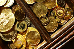 Gold coins in casket Royalty Free Stock Photo