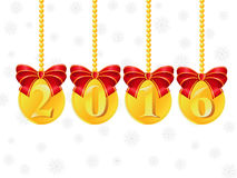 Gold coins. Christmas balls in the form of coins, with the inscription 2016 Stock Photography