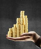 Gold coins city Stock Photos