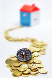 Gold coins, Compass and House in white background Royalty Free Stock Image