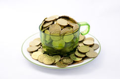 Gold Coins in a cup Stock Photo