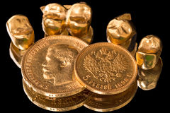 Gold coins and dental crowns Royalty Free Stock Photo