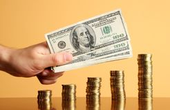 Gold coins and dollars royalty free stock photography