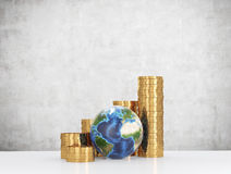 Gold coins and Earth Stock Photos