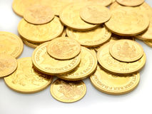 Gold coins embossed with images. Strewn around Royalty Free Stock Photo
