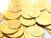 Gold coins embossed with images. Strewn around Stock Photos