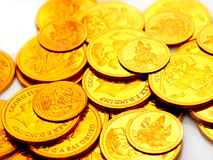 Gold coins embossed with images. Strewn around Royalty Free Stock Photos