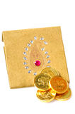 Gold coins on envelope Royalty Free Stock Images