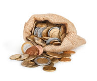 Gold coins fall out of a canvas bag Stock Photography