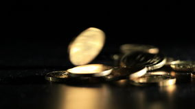 Gold coins falling over dark background. Macro shot. stock video footage