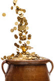 Gold coins falling in the vintage pot Stock Photos