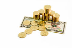 Gold coins on fifty dollars Royalty Free Stock Photography