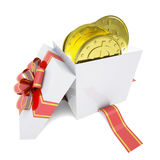 Gold coins in a gift box Stock Photography