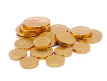 Gold coins. On white background stock images