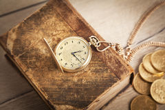 Gold coins and gold watch Royalty Free Stock Photography