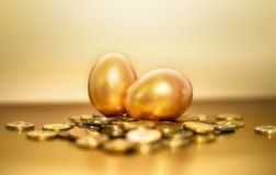 Gold coins and golden eggs, the concept of financial growth.  Royalty Free Stock Photos