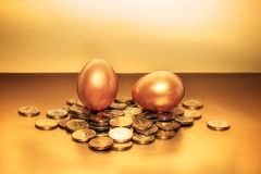 Gold coins and golden eggs, the concept of financial growth.  Stock Image