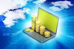 Gold coins graph  with laptop Stock Image
