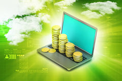 Gold coins graph  with laptop Stock Images