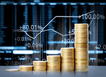 Gold coins and graph them Stock Images
