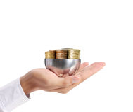 Gold coins in hand Royalty Free Stock Images